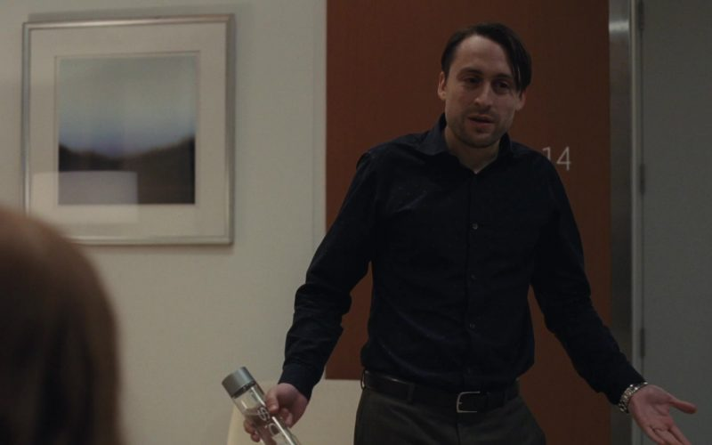 Voss Water Bottle Held by Kieran Culkin as Romulus 'Roman' Roy in Succession Season 1 Episode 2 Shit Show at the Fuck Factory