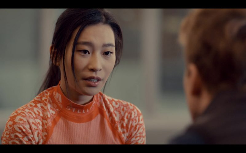 Adidas x Stella McCartney Winter Sports Orange Long Sleeve Turtleneck Top Worn by Amanda Zhou as Jenn in Spinni