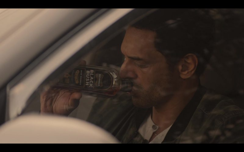 Bushmills Black Bush Whiskey Enjoyed by Tomer Sisley as Aviram Dahan in Messiah Season 1 Episode 3 The Finger of God (2020)