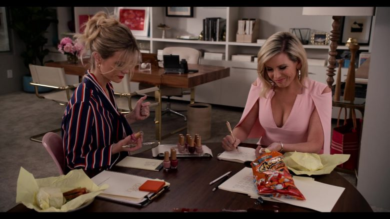 """Cheetos Crunchy Snack Enjoyed by June Diane Raphael and Brooklyn Decker in Grace and Frankie Season 6 Episode 13 """"The Change"""" (2020) TV Show"""