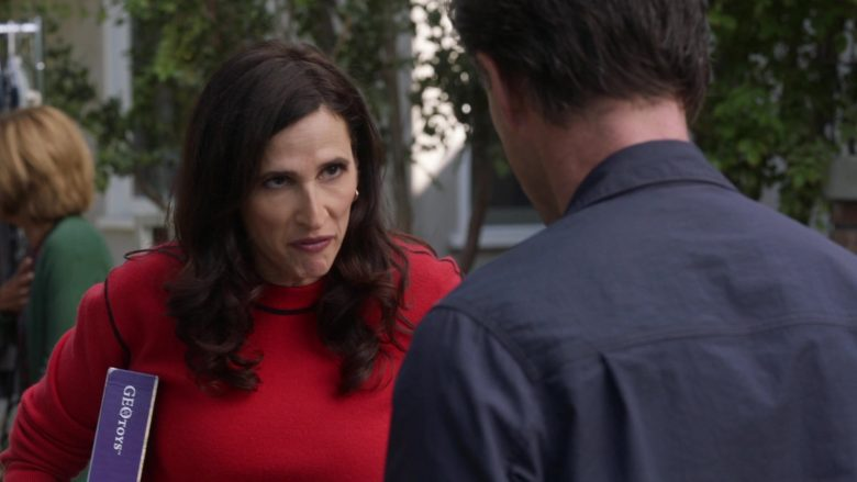"Geotoys Puzzle Held by Michaela Watkins as Delia in The Unicorn Season 1 Episode 11 ""If It Doesn't Spark Joy"" (2020) TV Show"