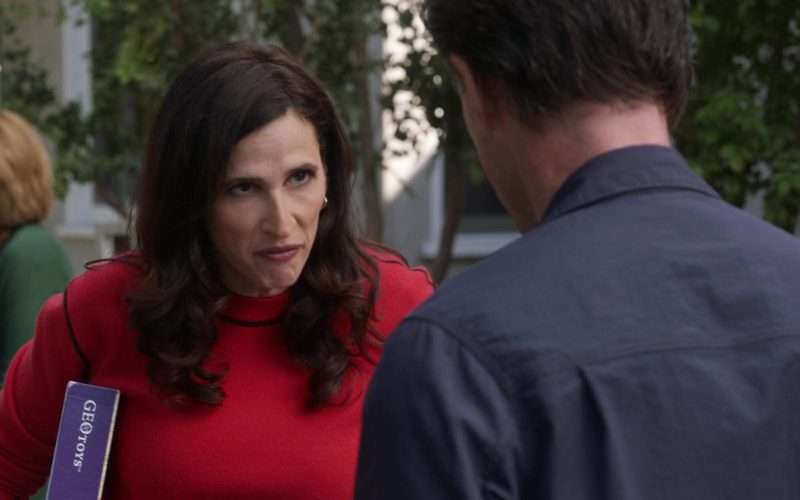 Geotoys Puzzle Held by Michaela Watkins as Delia in The Unicorn Season 1 Episode 11 If It Doesn't Spark Joy (1)