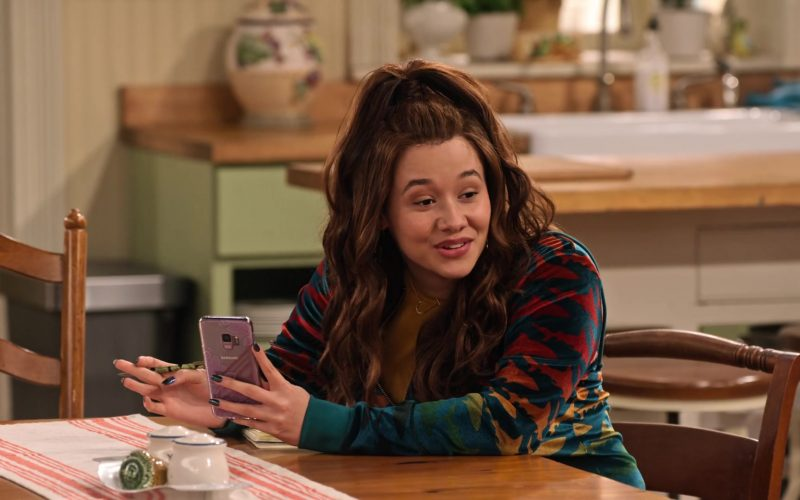 Samsung Galaxy Mobile Phone Held by Talia Jackson as Jade McKellan in Family Reunion Season 1 Episode 16