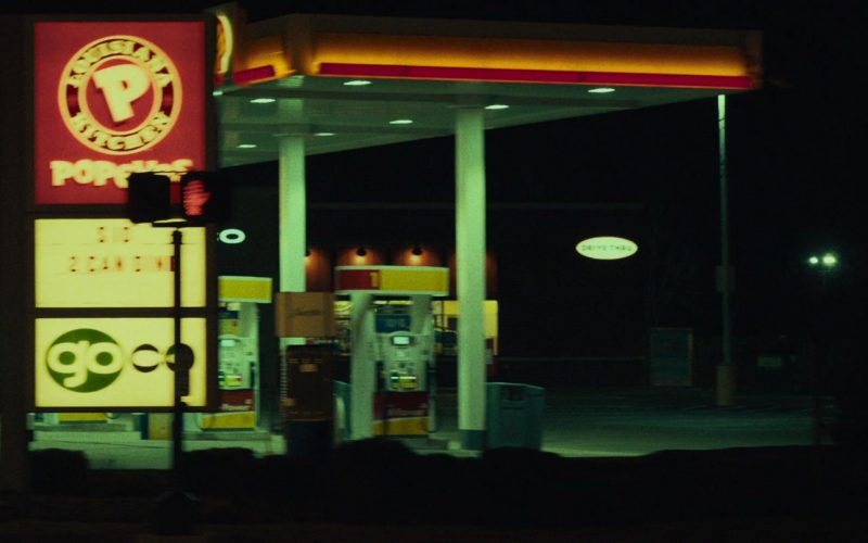Shell Filling Station and Popeyes Sign in Dark Waters (2019)