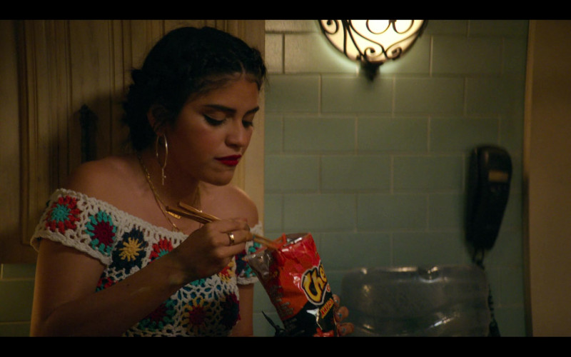 Cheetos Snack Enjoyed by Karrie Martin as Ana Morales in Gentefied S01E01 Casimiro (2020)