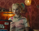 Maintain Chunks Dog Food Held by Margot Robbie as Harleen Quinzel in Birds of Prey (4)