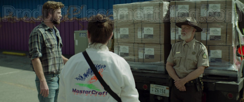 Clark Duke as Swin Wearing MasterCraft Ski Boats Logo White Jacket in Arkansas Movie (8)