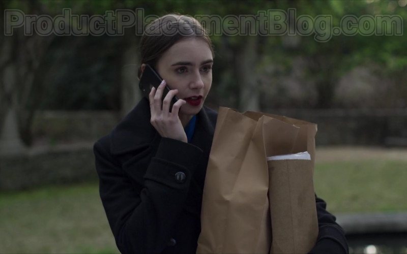 Actress Lily Collins as Lauren Monroe Using Apple iPhone Smartphone in Inheritance (2020) Movie