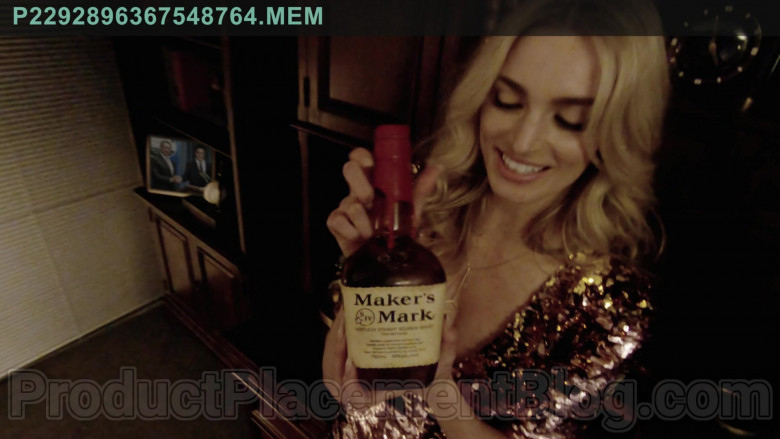 Maker's Mark Handmade Kentucky Straight Bourbon Whisky Bottle Held by Allegra Edwards in Upload TV Show (1)