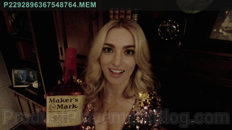 Maker's Mark Handmade Kentucky Straight Bourbon Whisky Bottle Held by Allegra Edwards in Upload TV Show (2)