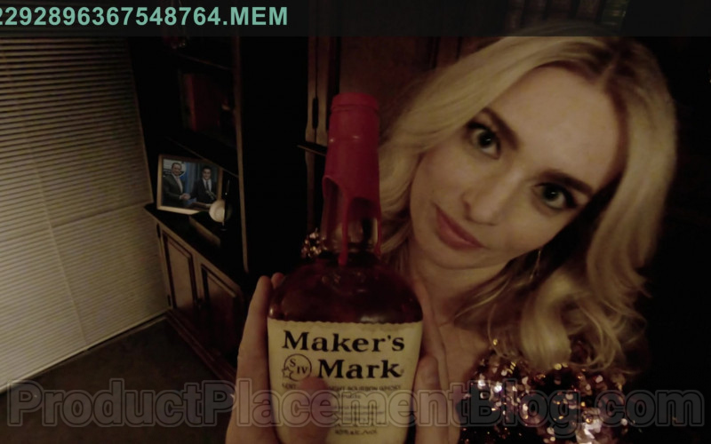 Maker's Mark Handmade Kentucky Straight Bourbon Whisky Bottle Held by Allegra Edwards in Upload TV Show (4)