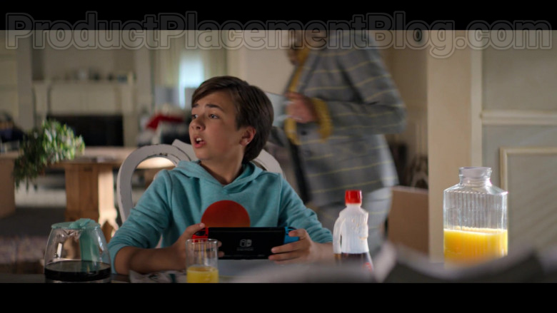 Young Actor Holding Nintendo Switch Video Game Console in Stargirl S01E02 S.T.R.I.P.E. TV Series (1)