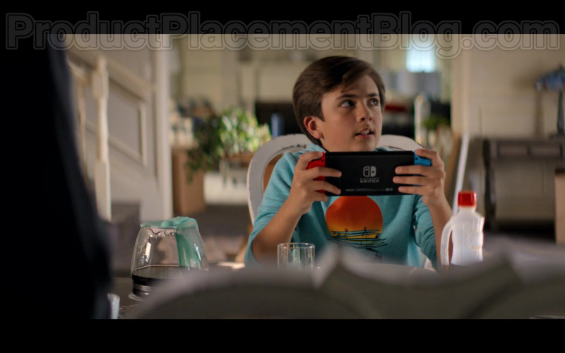 Young Actor Holding Nintendo Switch Video Game Console in Stargirl S01E02 S.T.R.I.P.E. TV Series (2)