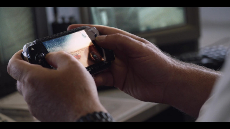 Actor Using PlayStation Portable (PSP) Gaming Console by Sony in Stateless S01E04