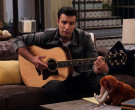 Taylor Guitar of Jencarlos Canela as Victor in The Expanding...