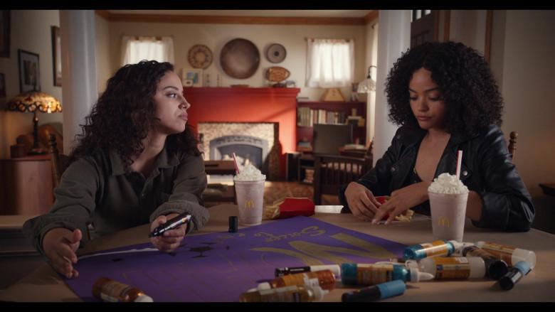 Actresses Kiana Madeira as Moe Truax & Quintessa Swindell Enjoying McDonald's Drinks in Trinkets S02E05 TV Show (1)