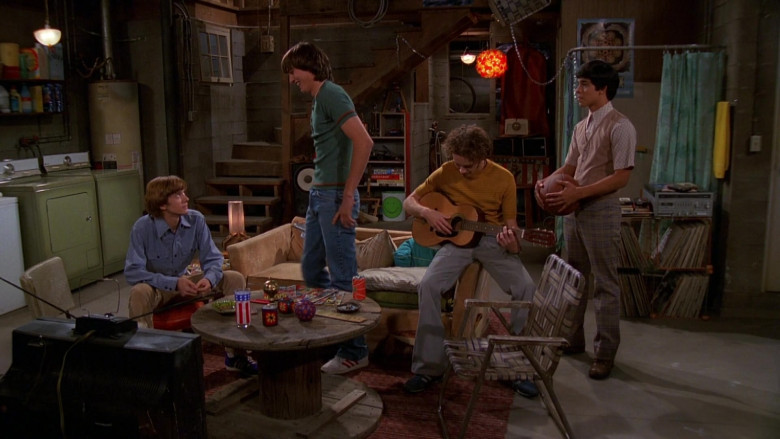 Adidas Shoes, Blue Jeans and Green T-Shirt Outfit of Ashton Kutcher as Michael Kelso in That '70s Show S01E02