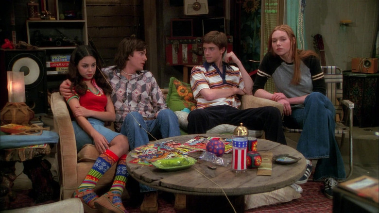 Adidas Sneakers, Flared Jeans Long Sleeve T-Shirt Outfit of Laura Prepon as Donna Pinciotti in That '70s Show (1)