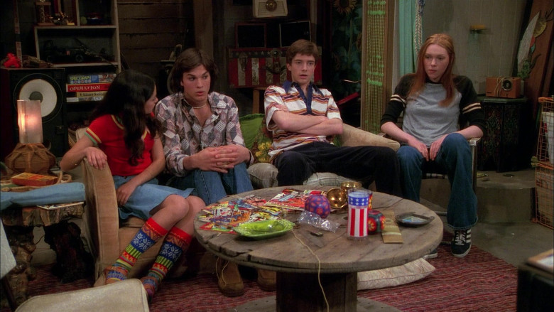 Adidas Sneakers, Flared Jeans Long Sleeve T-Shirt Outfit of Laura Prepon as Donna Pinciotti in That '70s Show (2)