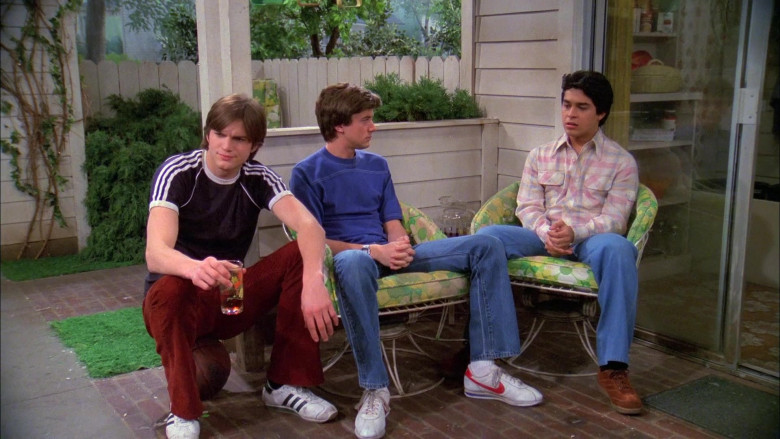 Adidas White Sneakers, Black T-Shirt and Stylish Pants Worn by Ashton Kutcher as Michael in That '70s Show