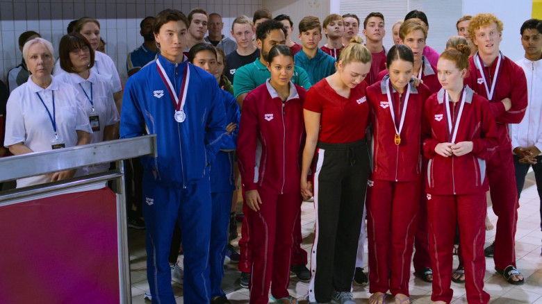 Arena Red Tracksuits Outfits of Actors in Swimming for Gold