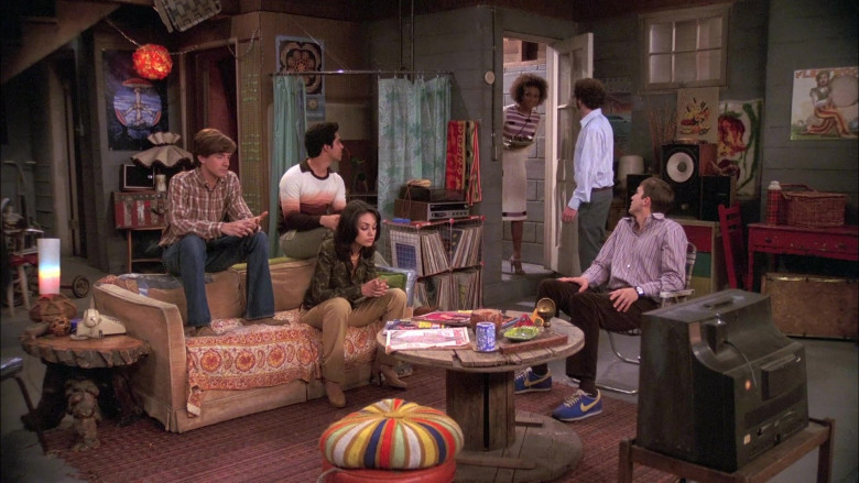 Ashton Kutcher as Michael Kelso Wears Nike Sneakers, Brown Velvet Trousers and Striped Shirt Outfit in That '70s Show
