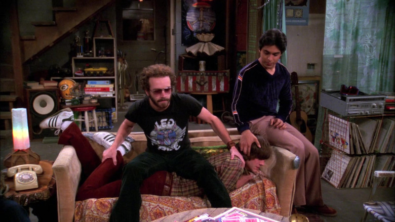 Ashton Kutcher as Michael Wears Adidas Sneakers, Red Flared Pants and Plaid Shirt Outfit in That '70s Show (2)