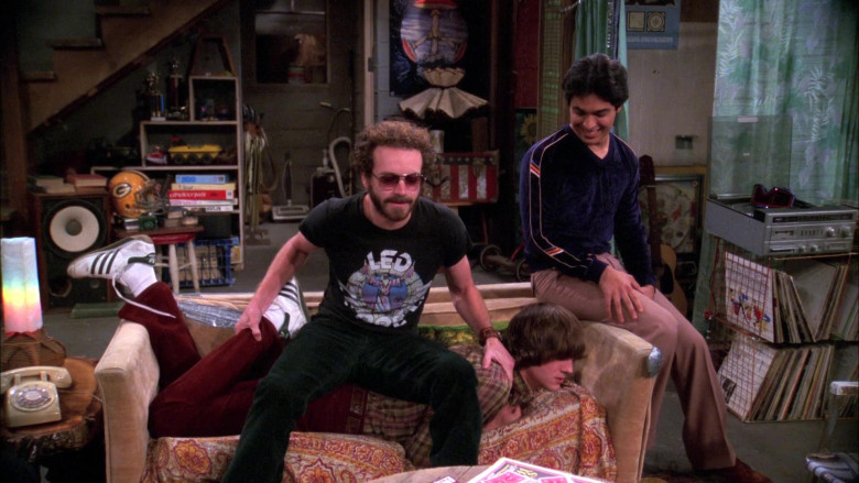 Ashton Kutcher as Michael Wears Adidas Sneakers, Red Flared Pants and Plaid Shirt Outfit in That '70s Show (3)