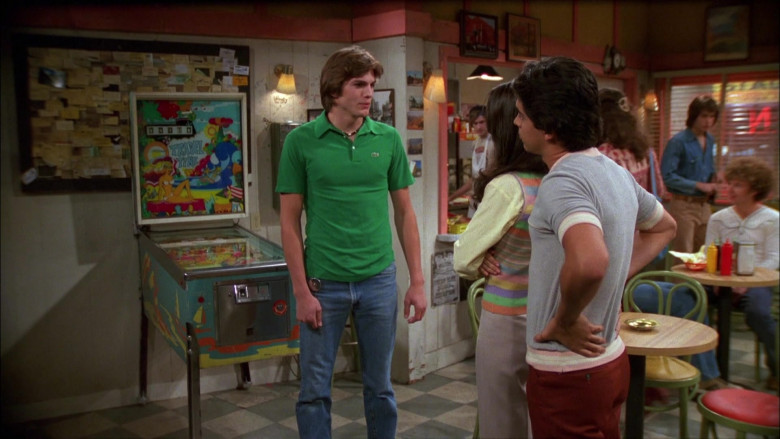 Ashton Kutcher as Michael Wears Lacoste Green Shirt and Classic Jeans Outfit in That '70s Show (1)