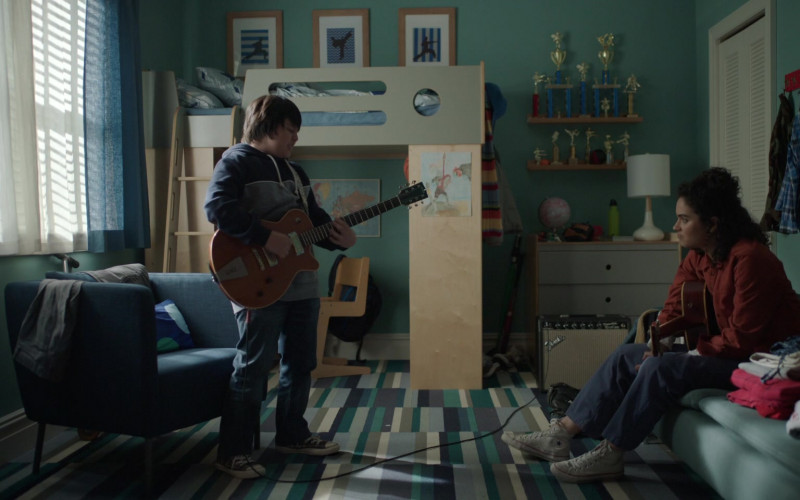 Brittany O'Grady Wears Converse Shoes, Pants and Red Jacket Outfit in Little Voice Season 1