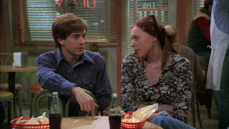 Coca-Cola Soda Drinks Enjoyed by Topher Grace as Eric Forman & Laura Prepon as Donna Pinciotti in That '70s Show