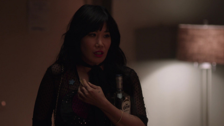 Jose Cuervo Tequila Bottle Held by Vivian Bang in Room 104 S04E04