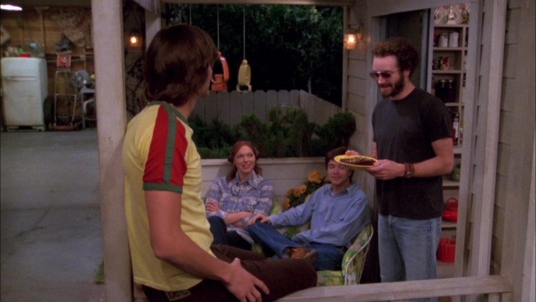 Lee Brown Trousers and Yellow Tee Casual Outfit of Ashton Kutcher as Michael in That '70s Show (1)
