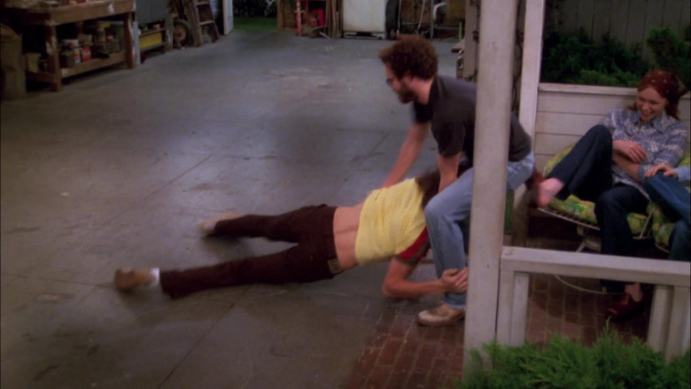 Lee Brown Trousers and Yellow Tee Casual Outfit of Ashton Kutcher as Michael in That '70s Show (2)