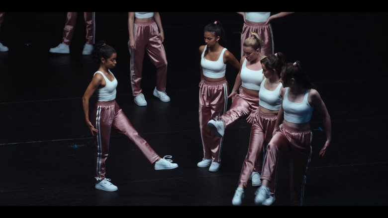 Liza Koshy Wears Nike Women's White Sneakers, Pink Pants and Crop Top Outfit
