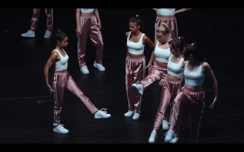 Liza Koshy Wears Nike Women's White Sneakers, Pink Pants and White Tee Outfit