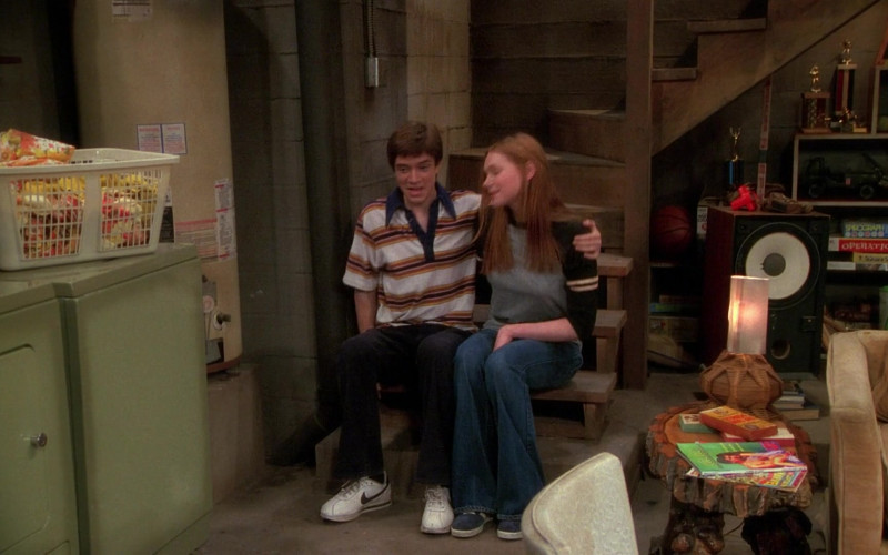 Nike Sneakers, Velvet Pants and Striped Short Sleeved Shirt Outfit of Topher Grace as Eric Forman in That '70s Show