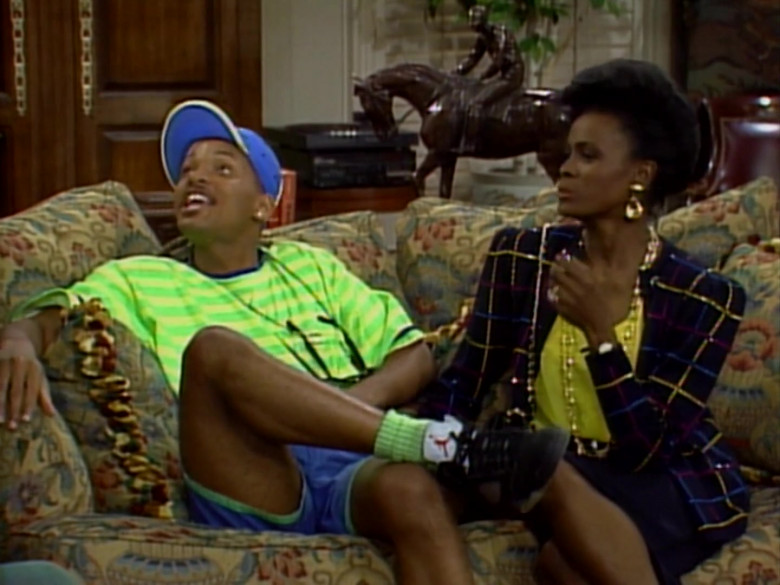 Will Smith Wears Air Jordan Black Sneakers, Green T-Shirt and Blue Shorts Outfit (1)