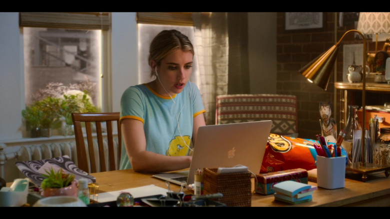 Apple MacBook Air Laptop and Cheetos Snack of Emma Roberts as Sloane in Holidate Movie (1)