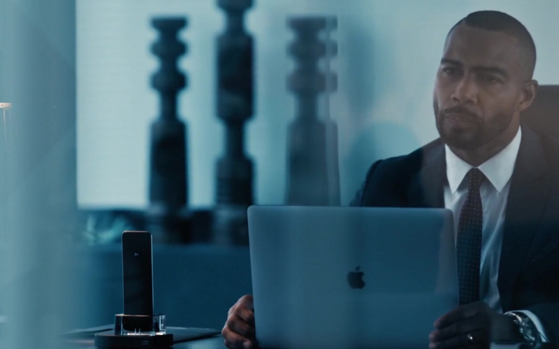 Apple MacBook Laptop and Motorola Phone of Omari Hardwick as Marquis T. Woods in Spell (2020)