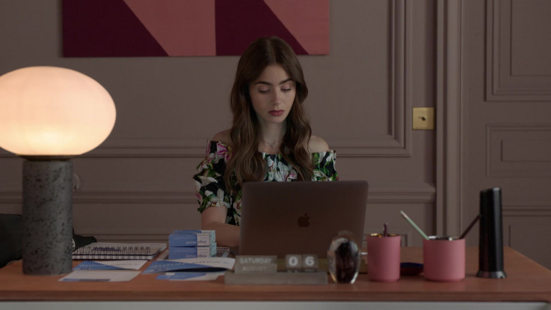 Apple MacBook Laptop on the Desk of Lily Collins in Emily in Paris S01E02 (2)