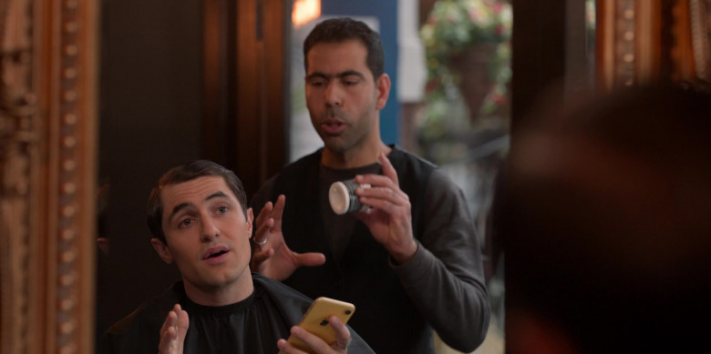 Apple iPhone Yellow Smartphone Held by Actor in Ted Lasso S01E10