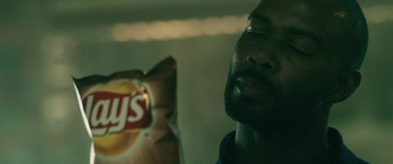 Lay's Chips Held by Omari Hardwick as Marquis T. Woods in Spell 2020 Movie (2)