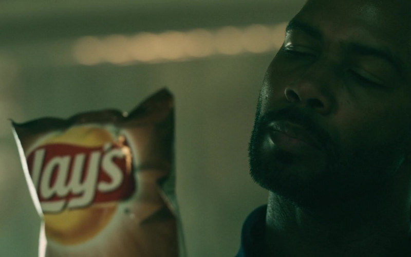 Lay's Chips Held by Omari Hardwick as Marquis T. Woods in Spell 2020 Movie (2)