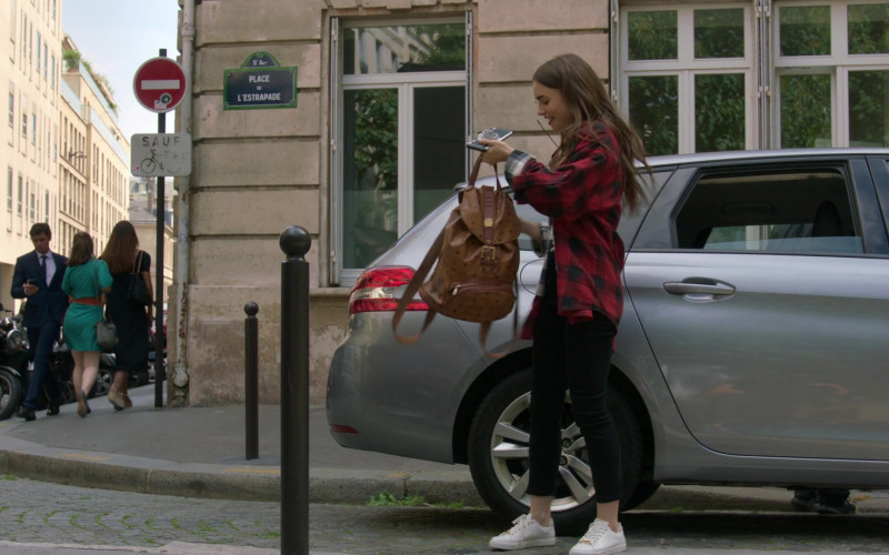 MCM Worldwide Leather Brown Backpack of Lily Collins in Emily in Paris – Season 1 Ep. 1 (2020)