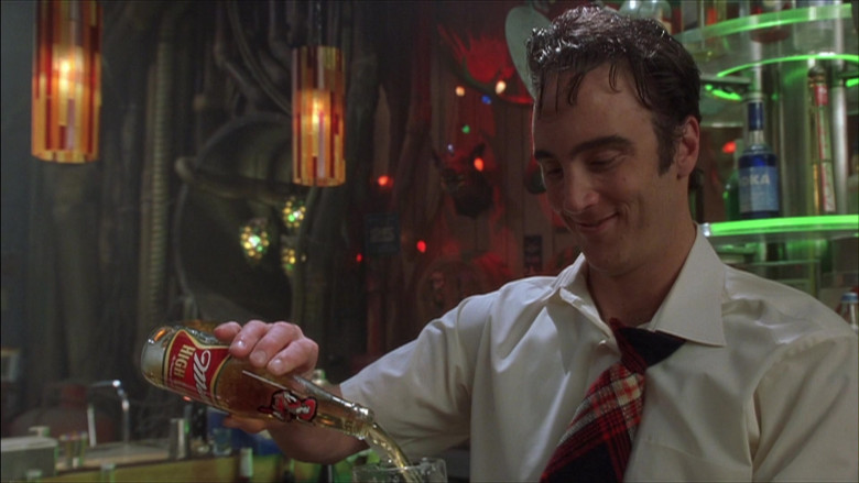 Miller High Life Beer Bottle Held by Jay Mohr in The Adventures of Pluto Nash (2002)