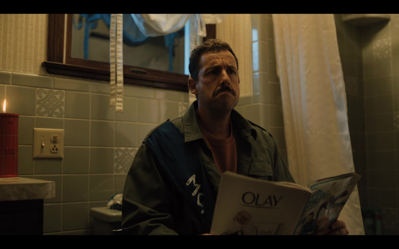 Olay Skin Care Advertising in the Magazine Held by Adam Sandler in Hubie Halloween (1)