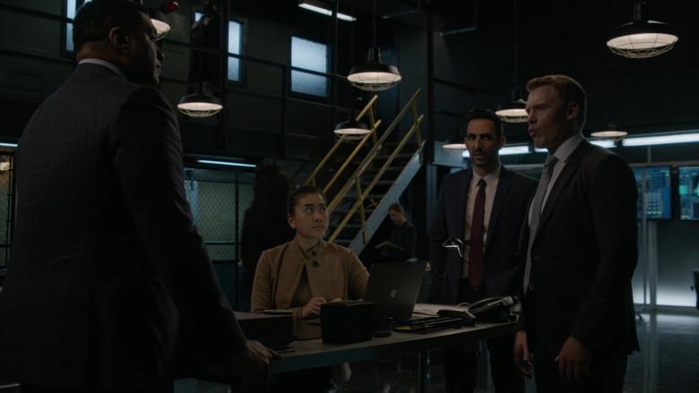 Apple MacBook Laptop of Laura Sohn as Agent Alina Park in The Blacklist S08E01 Roanoke (2020)