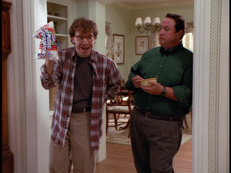 Kraft Jet-Puffed Marshmallows Held by Rick Moranis as Wayne Szalinski in Honey, We Shrunk Ourselves! (1997)