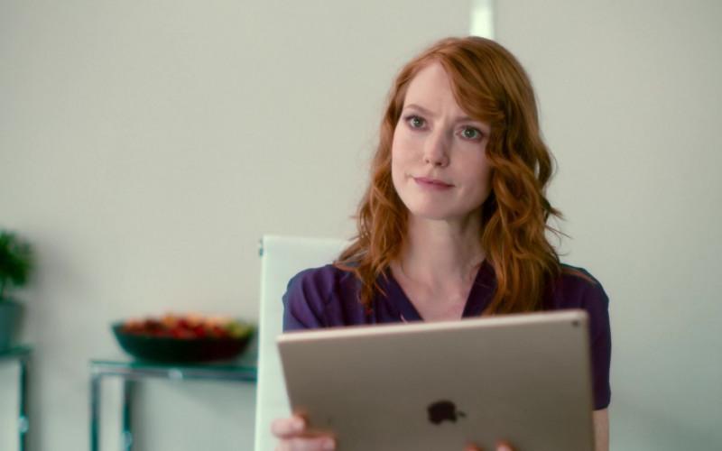 Apple iPad Tablet Held by Alicia Witt as Wren Cosgrove in Modern Persuasion (2020)